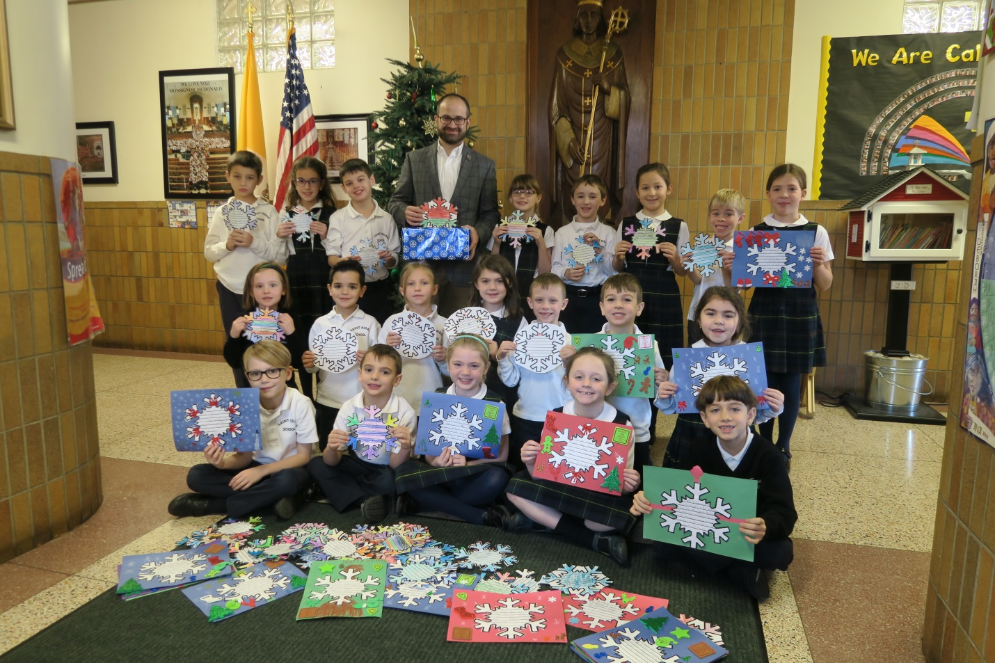 Assemblyman Ed Ra (R-Franklin Square) with students from St. Aidan's lower school who participated in his annual Snowflakes for Seniors program to spread holiday cheer to local senior citizens.