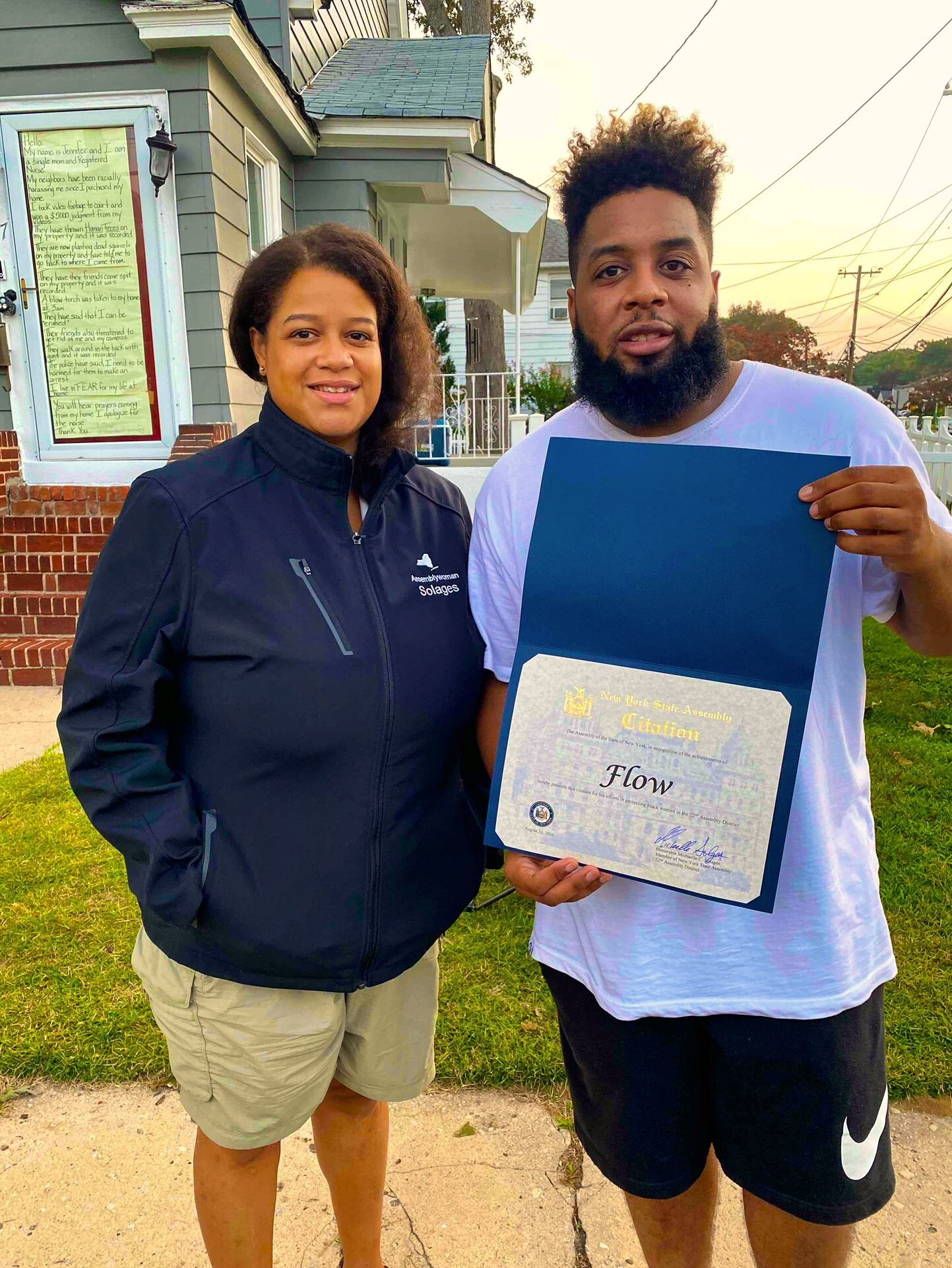 Assemblywoman Michaelle Solages joined community activist FLOW to commemorate his 30th day of watching over Jennifer McLeggan and her home. FLOW has shown great leadership in this unfortunate situatio
