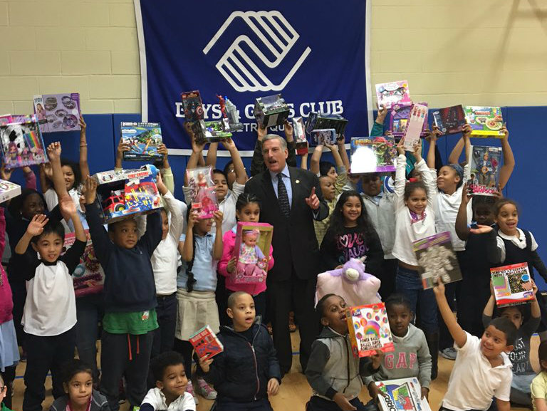 Children join Assemblyman David Weprin and display gifted toys from the Assemblyman's Holiday Toy Drive to benefit the Boys & Girls Club of Metro Queens.