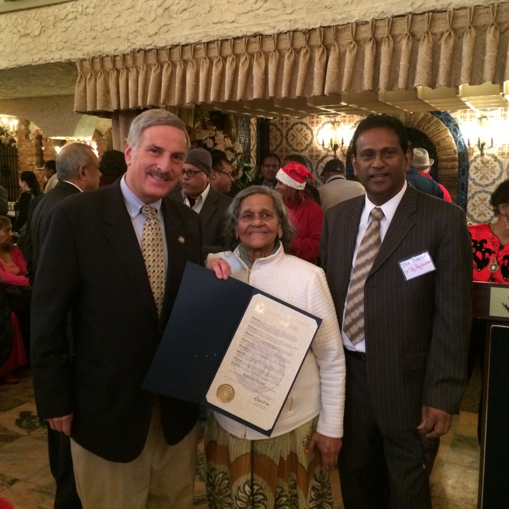 Assemblyman Weprin presents Citations to senior citizens at the Inter-Community Civic Association Senior End-of-Year Luncheon. Pictured with Assemblyman Weprin are Rukhminee Persaud & Dr. Taj Rajkumar.