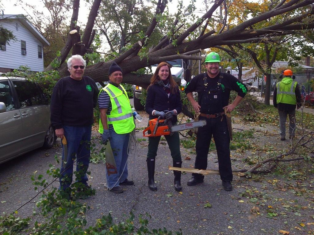 Assemblywoman Nily Rozic joined local volunteers to help cleanup efforts after Hurricane Sandy in Hillcrest.