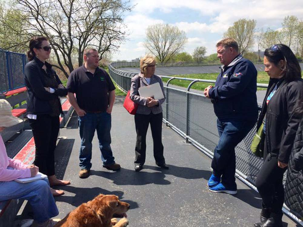 Assemblywoman Nily Rozic and local residents discussed community concerns during a neighborhood walkthrough with City Parks Queens Borough Commissioner Dottie Lewandowski.