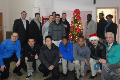 On Tuesday, December 20, 2011, Assemblyman Braunstein and his staff delivered gifts for veterans at the St. Albans Community Living Center of the VA New York Harbor Healthcare System and the New York State Veterans' Home at St. Albans with students from Holy Cross High School, and Michael Genovese, Director of Service Learning.