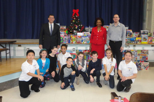 On December 18, 2012, Assemblyman Braunstein received donations for his Holiday Toy Drive from PS 98, pictured here with PS 98's Principal Sheila Huggins, Chief of Staff David Fischer and PS 98's Student Council.