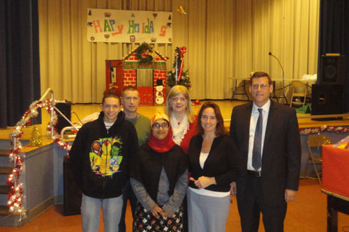 On December 18, 2012, Assemblyman Braunstein received donations for his Holiday Toy Drive from PS 811Q, pictured here with PS 811's Principal Penny Ryan, staff and students