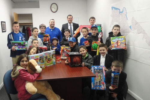 On December 17, 2012, Assemblyman Braunstein received donations for his Holiday Toy Drive from the Whitestone Angels.