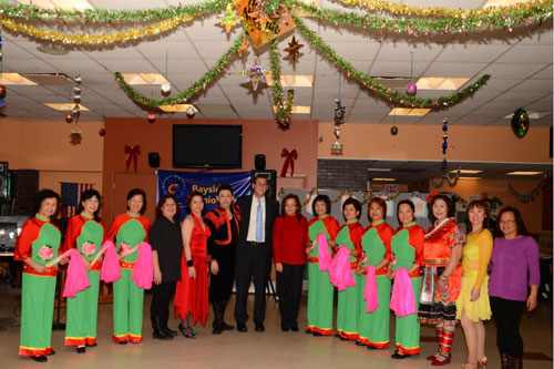 On December 29, 2012, Assemblyman Braunstein visited the Key Luck Club at Bayside Senior Center to watch their holiday performances, pictured here with President Irene Cheung and the performers.