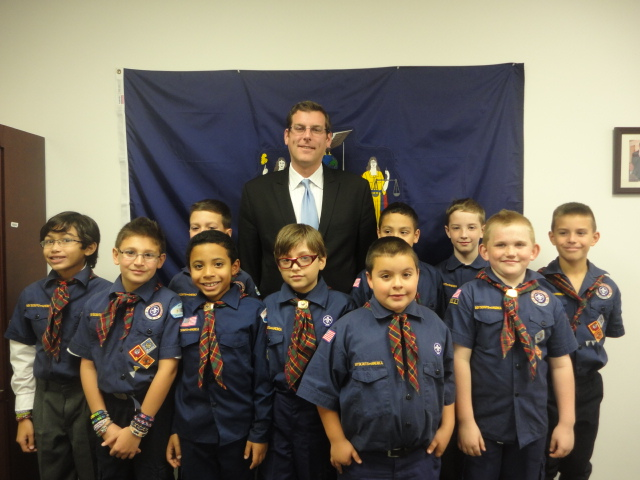 On Friday, November 15, 2013, Assemblyman Braunstein hosted Sacred Heart Cub Scout Pack 49 at his District Office. He discussed with the Cub Scouts how a bill becomes a law in the State Assembly, whic