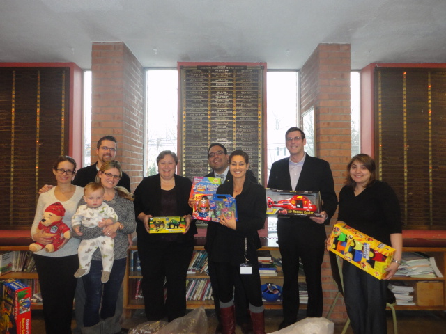 On December 17, 2013, Assemblyman Braunstein delivered toys donated to his annual Holiday Toy Drive to QSAC Preschool & Early Childhood Center of Douglaston, pictured here with staff and parents of st