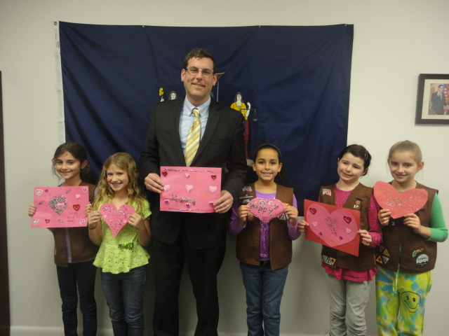 On Friday, February 7, 2014, Assemblyman Braunstein received donations from Girl Scout Troop 4563 for his Valentines for Vets Gift Drive.