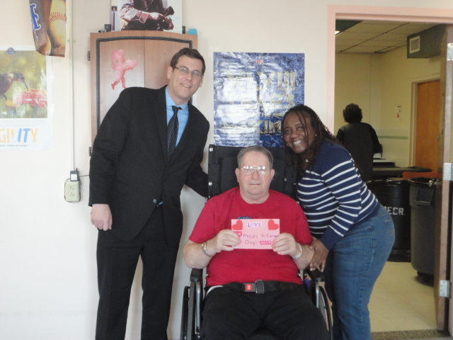 On February 14, 2014, Assemblyman Braunstein visited the St. Albans Community Living Center of the VA New York Harbor Healthcare System to deliver donations from the 18th Annual Valentines for Vets gift drive. Assemblyman Braunstein is pictured with Victoria Townes, Recreation Assistant; and United States Air Force E-5 James Remias, a veteran of the Vietnam War.