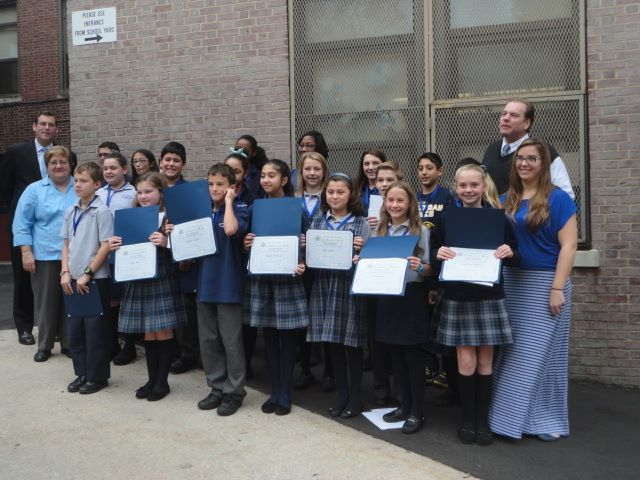 On Thursday, November 7, 2013, Assemblyman Braunstein inducted the newly-elected Student Council Representatives and Officers at Divine Wisdom Catholic Academy - Douglaston. Assemblyman Braunstein is pictured here with Principal Michael A. LaForgia, Associate Principal Linda Keppel, and Student Council Moderator Ms. Michelle Furlong, and the Student Council Representatives.