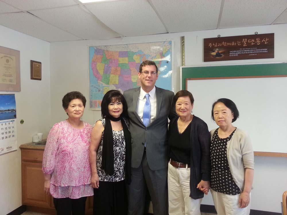 Assemblyman Braunstein is pictured with Executive Director Sunny Kim and members of KACCNY.
