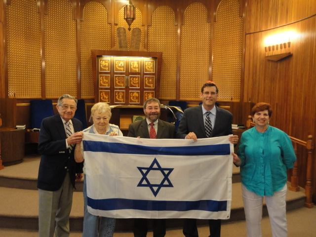 On July 24, 2014, Assemblyman Braunstein presented a new Israeli flag to the members of the Clearview Jewish Center. Assemblyman Braunstein is pictured with Rabbi David Taub, Clearview Jewish Center P