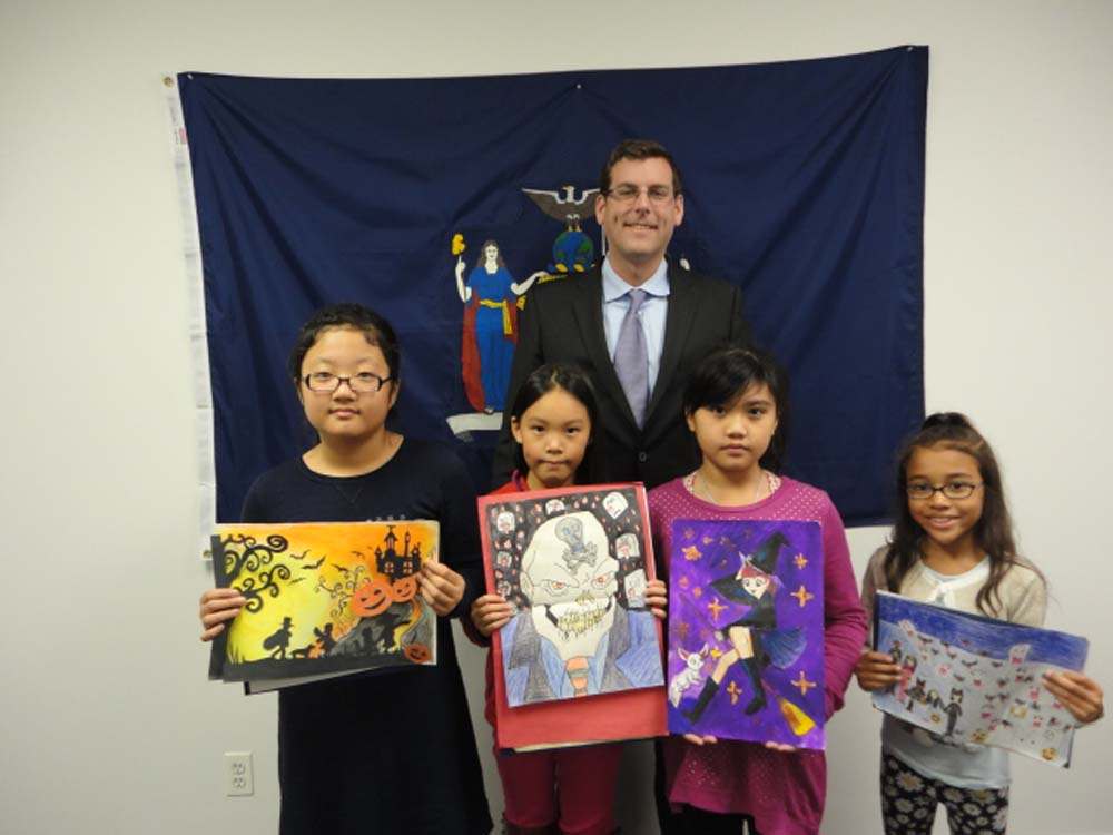 On November 24, 2014, Assemblyman Braunstein congratulated the winners of his Halloween Essay and Drawing Contest 2014. Assemblyman Braunstein is pictured with 3rd Grade Grand Prize Winner Ashley Cho,