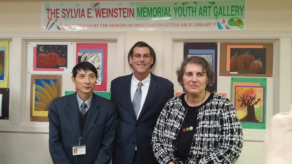 Assemblyman Braunstein attended the Second Unveiling of the Sylvia E. Weinstein Youth Art Gallery. Assemblyman Braunstein is pictured with Branch Manager Ron Wan and Arline Abdalian, President of the