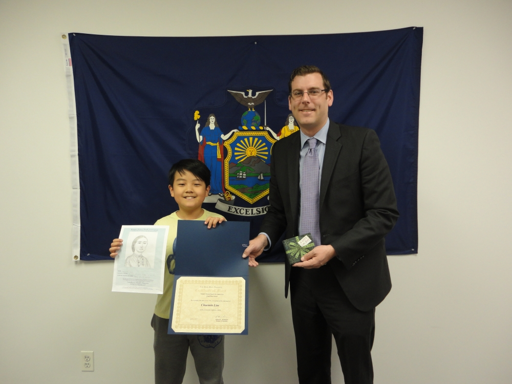 On April 30, 2015, Assemblyman Braunstein congratulated the winner of his Women's History Month Contest, Chaemin Lim, a 4th Grade student at PS 32: State Street School in Auburndale.