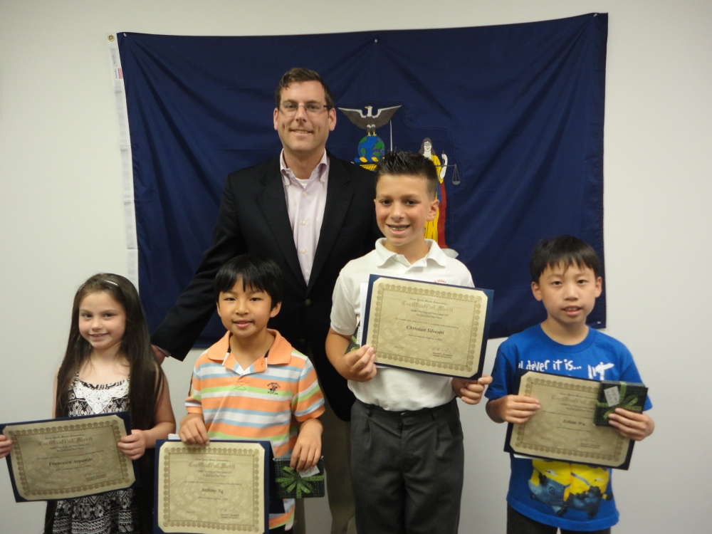 On June 5, 2015, Assemblyman Braunstein congratulated the winners of his Mother's Day Essay and Poetry Contest 2015. Assemblyman Braunstein is pictured with 2nd Grade Grand Prize Winner Francesca Arge