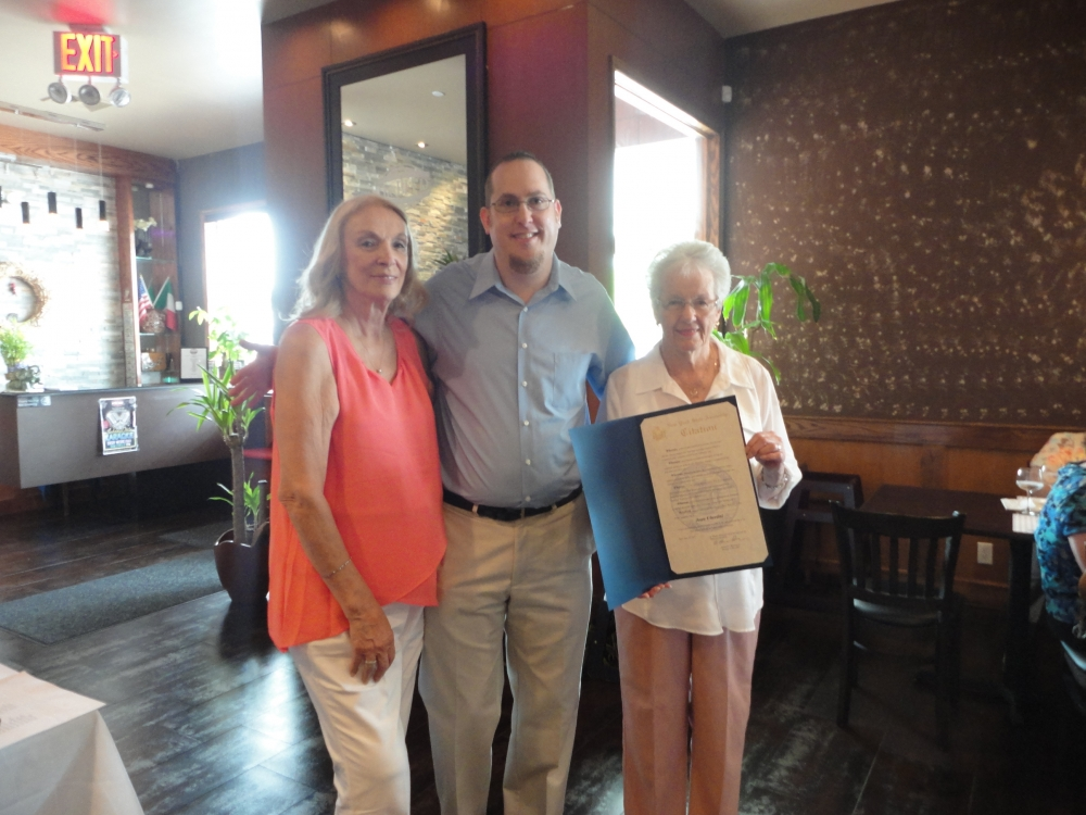 On June 23, 2015, my Chief of Staff David Fischer presented a citation on my behalf to Joan Ubertini, former Director of the Greater Whitestone Taxpayers Community Center. David Fischer is pictured wi