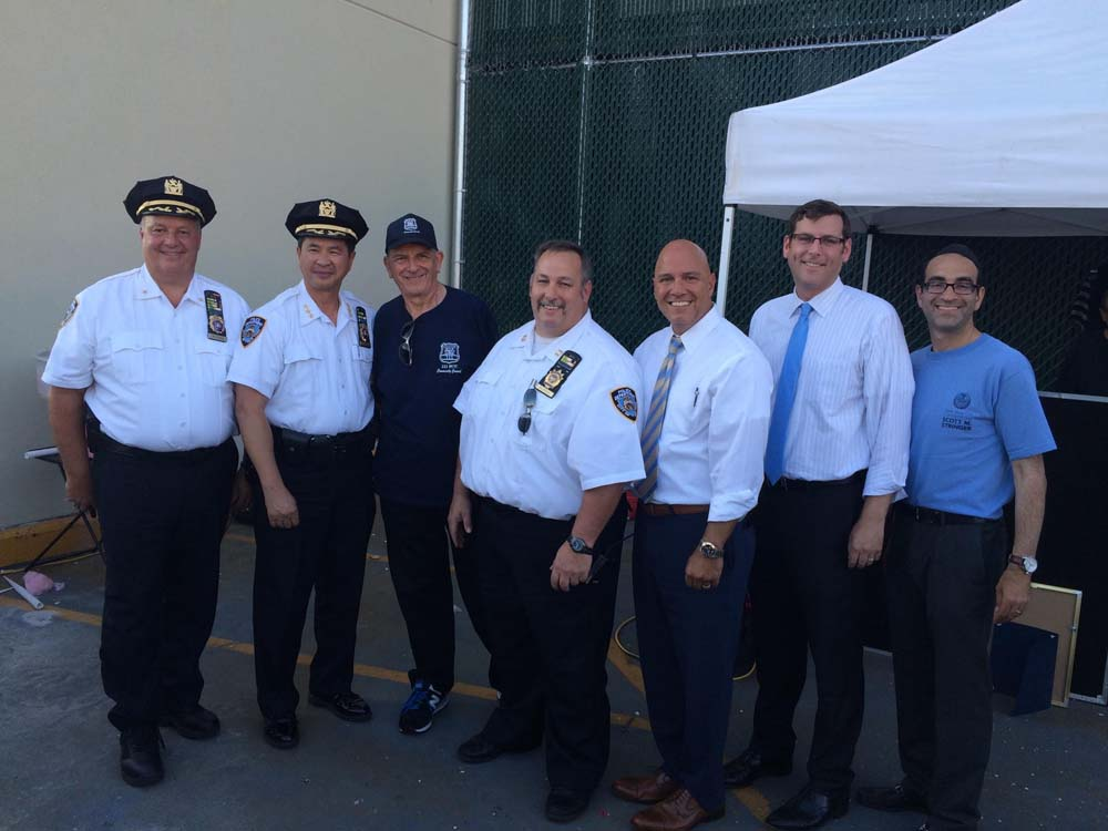 On August 4, 2015, Assemblyman Braunstein attended the 111th Precinct's National Night Out Against Crime. Assemblyman Braunstein is pictured with NYPD Chief of Transportation Thomas Chan, 111th Precin