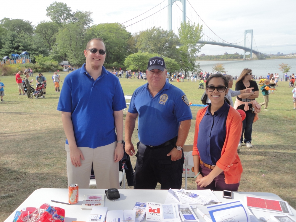 On September 26, 2015, Assemblyman Braunstein's staff held a Mobile District Office at the 2nd Annual Family Fun Day sponsored by the 109th Precinct Community Council and We Love Whitestone. Assemblyman Braunstein's Chief of Staff David Fischer and Legislative Director Meagan Chen are pictured with Detective Kevin O'Donnell.