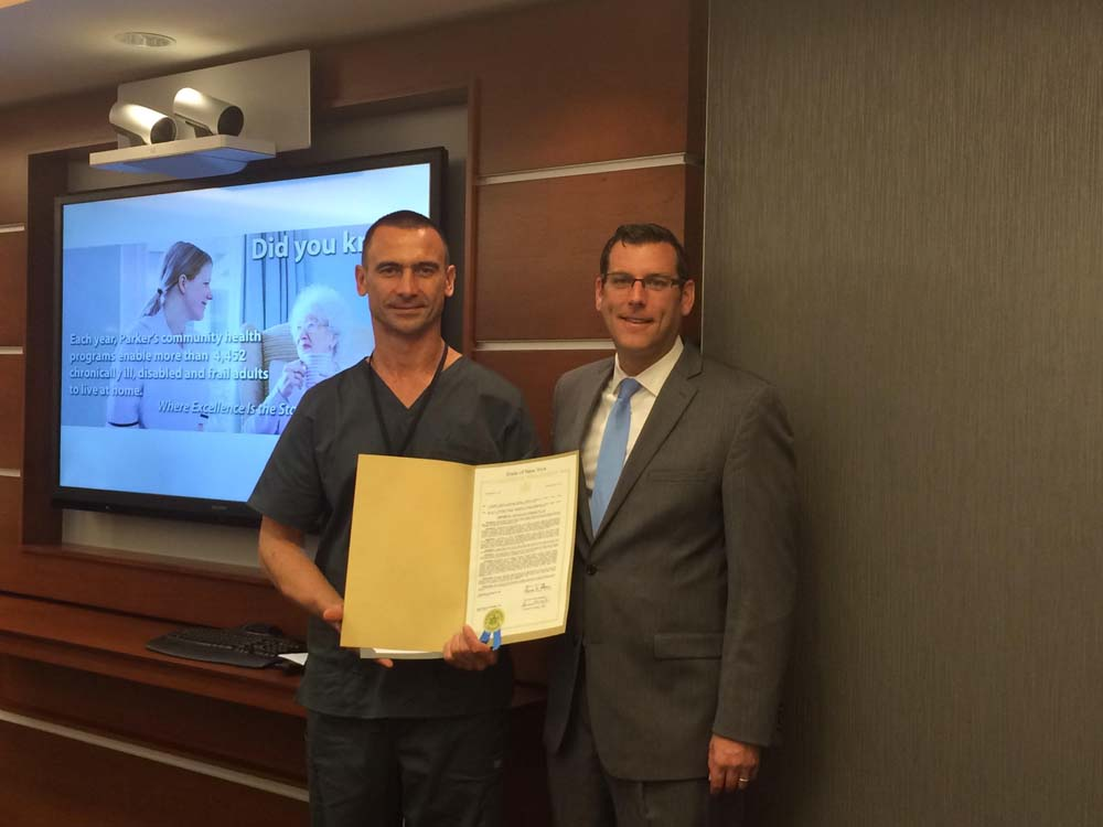 On October 13, 2015, Assemblyman Braunstein presented a NYS Legislative Resolution to Pawel Jakubiec, recipient of the LeadingAge New York Employee of Distinction Award. Assemblyman Braunstein is pict