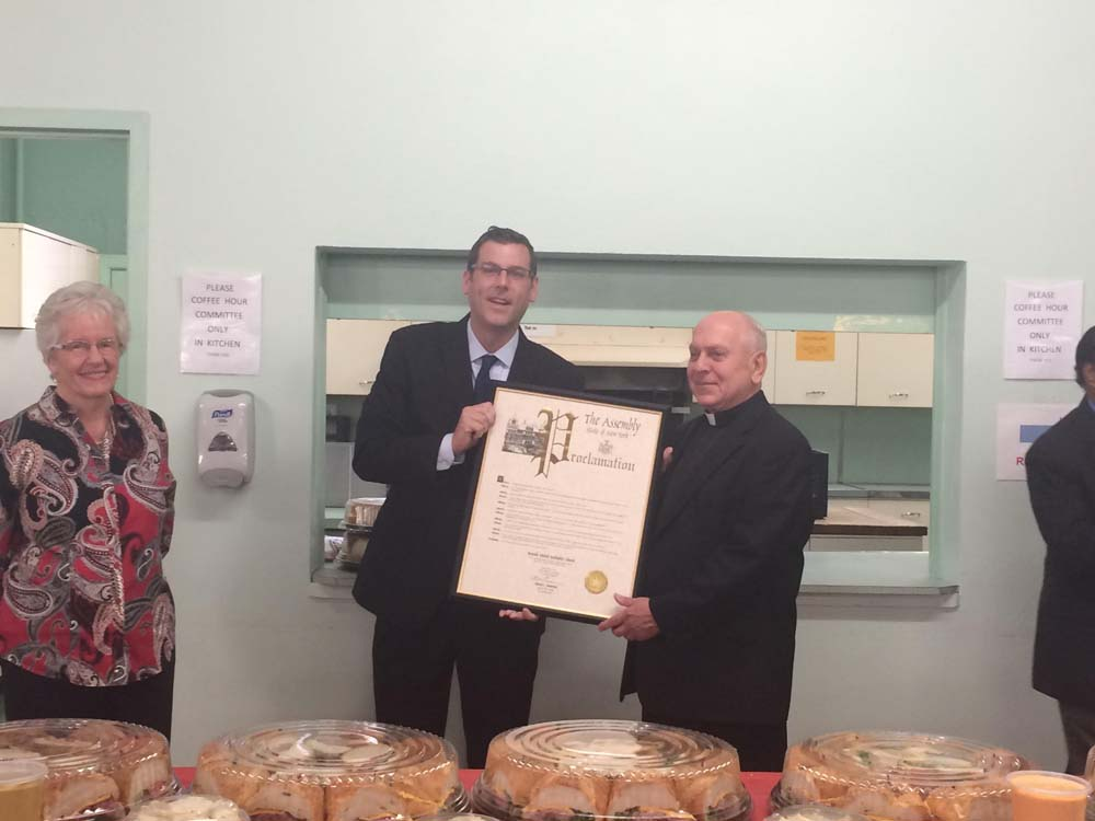 On October 11, 2015, Assemblyman Braunstein presented a NYS Assembly Proclamation to Bayside United Methodist Church in celebration of its 125th Anniversary. Assemblyman Braunstein is pictured with Pa