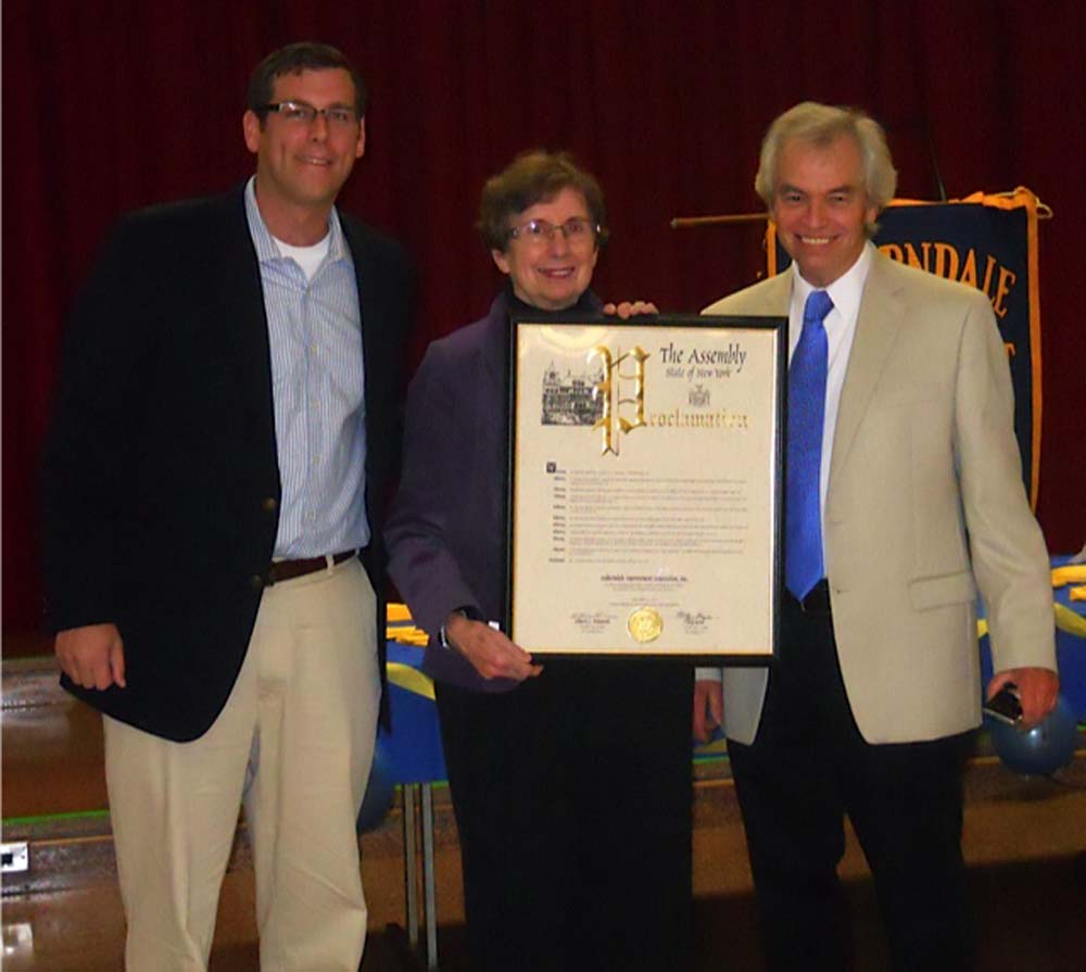 On October 20, 2015, Assemblyman Braunstein presented a NYS Assembly Proclamation to the Auburndale Improvement Association in recognition of its 100th Anniversary. Assemblyman Braunstein is pictured