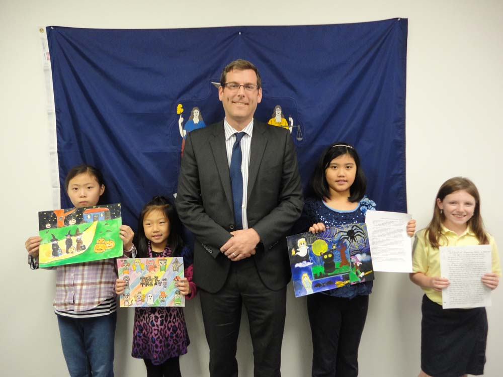 On November 19, 2015, Assemblyman Braunstein congratulated the winners of his Halloween Essay and Drawing Contest 2015. Assemblyman Braunstein is pictured with 3rd Grade Grand Prize Winner Sabrina Xu,