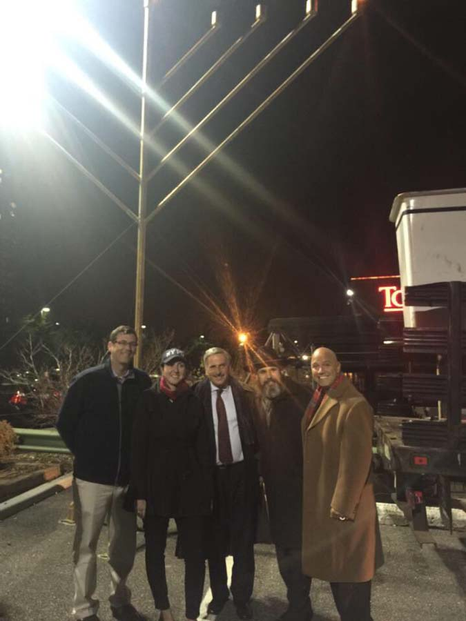 On December 6, 2015, Assemblyman Braunstein attended the Giant Menorah Lighting at the Chabad of Northeast Queens. Assemblyman Braunstein is pictured with Assemblywoman Nily Rozic, Assemblyman David W