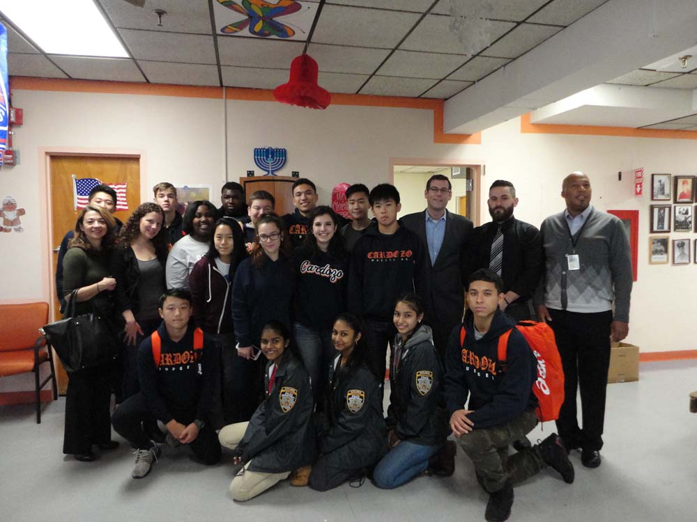 On December 18, 2014, Assemblyman Braunstein and Benjamin N. Cardozo High School students delivered donations from his annual Veterans' gift drive to the St. Albans VA Community Living Center, picture