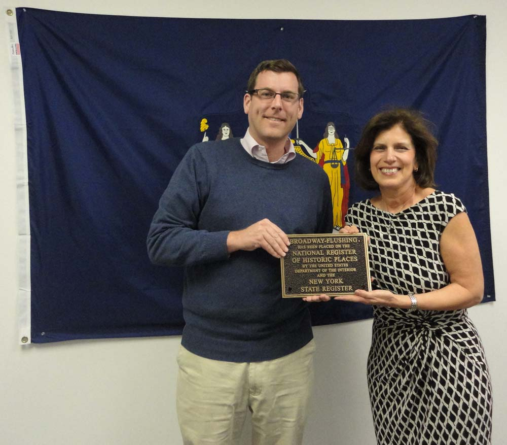 On March 18, 2016, Broadway-Flushing Homeowners' Association member Maria Becce presented a bronze plaque to Assemblyman Braunstein for him to display in his District Office. The plaque signifies the