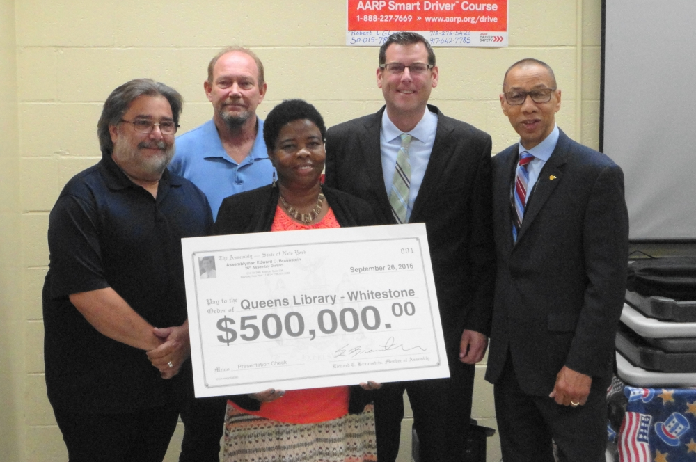 On September 26, 2016, Assemblyman Braunstein was joined by Dennis Walcott, President and CEO of Queens Library, and local civic leaders, as he announced a $500,000 grant to replace the roof of the Wh