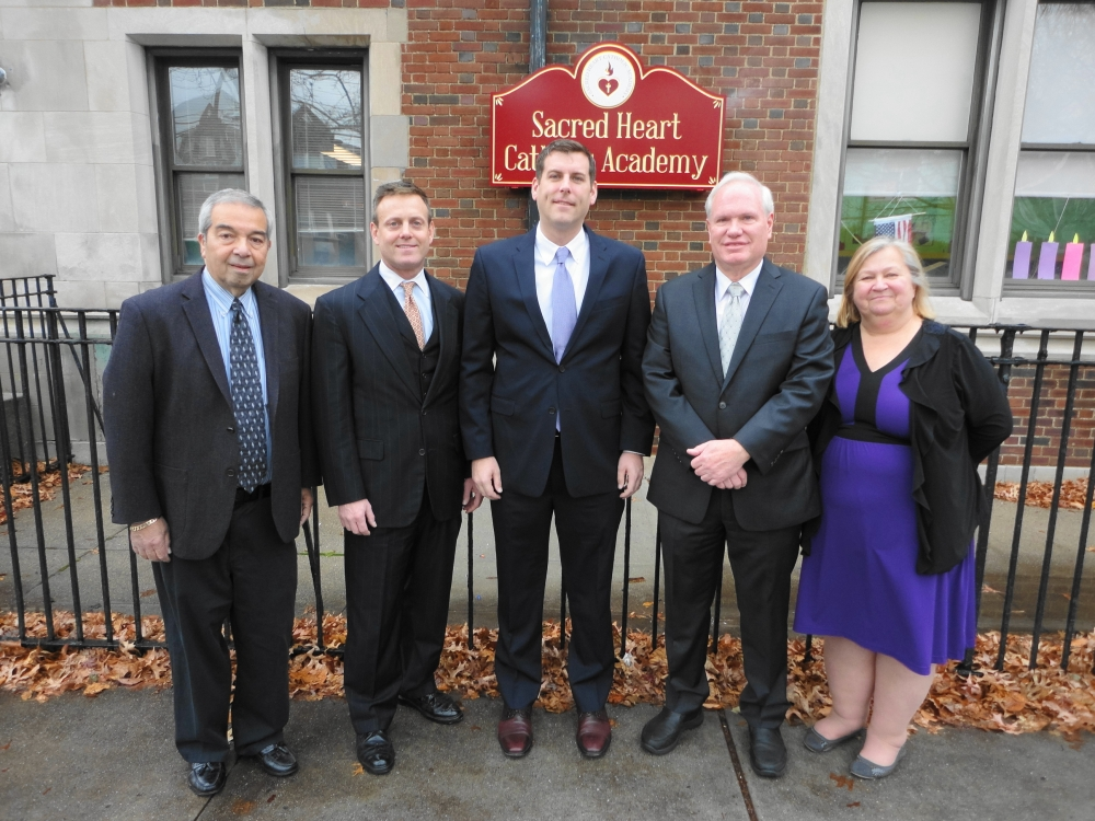 On December 12, 2016, Assemblyman Braunstein attended the unveiling of the new school sign at Sacred Heart Catholic Academy.