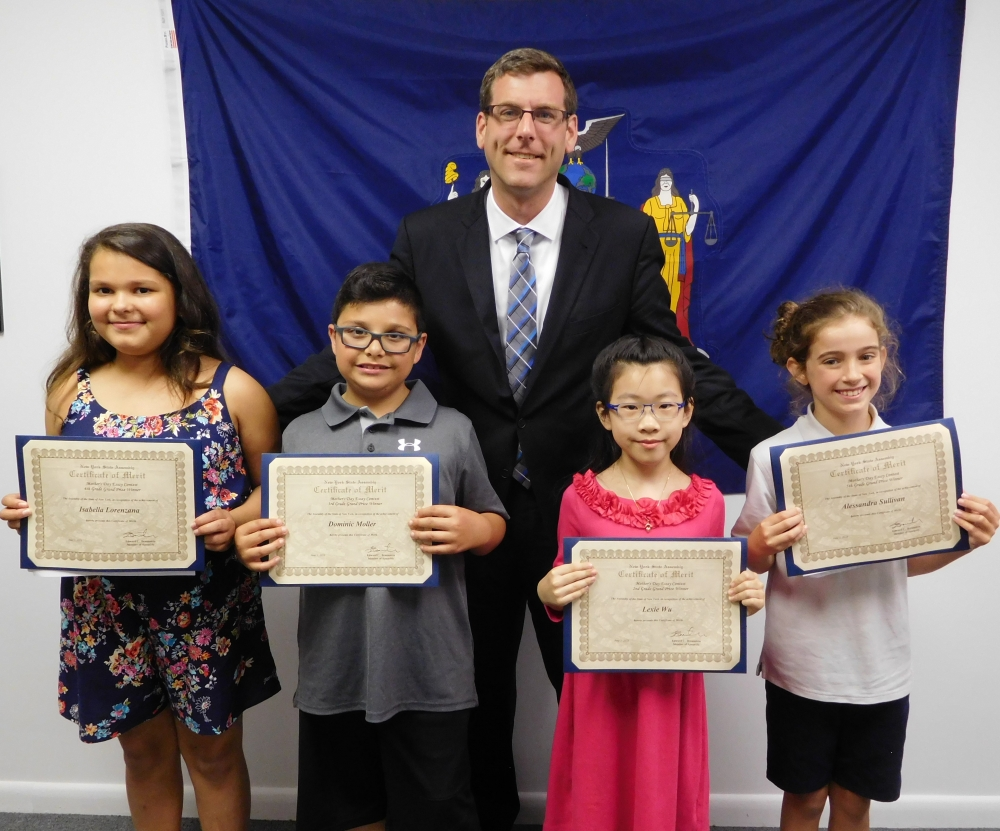 On June 1, 2018, Assemblyman Braunstein met with the winners of his annual Mother&rsquo;s Day Essay Contest. Assemblyman Braunstein is pictured with Isabella Lorenzana, 4th Grade Grand Prize Winner; Dominic Moller, 3rd Grade Grand Prize Winner; Lexie Wu, 2nd Grade Grand Prize Winner, and, Alessandra Sullivan, 5th Grade Grand Prize Winner.<br />&nbsp;
