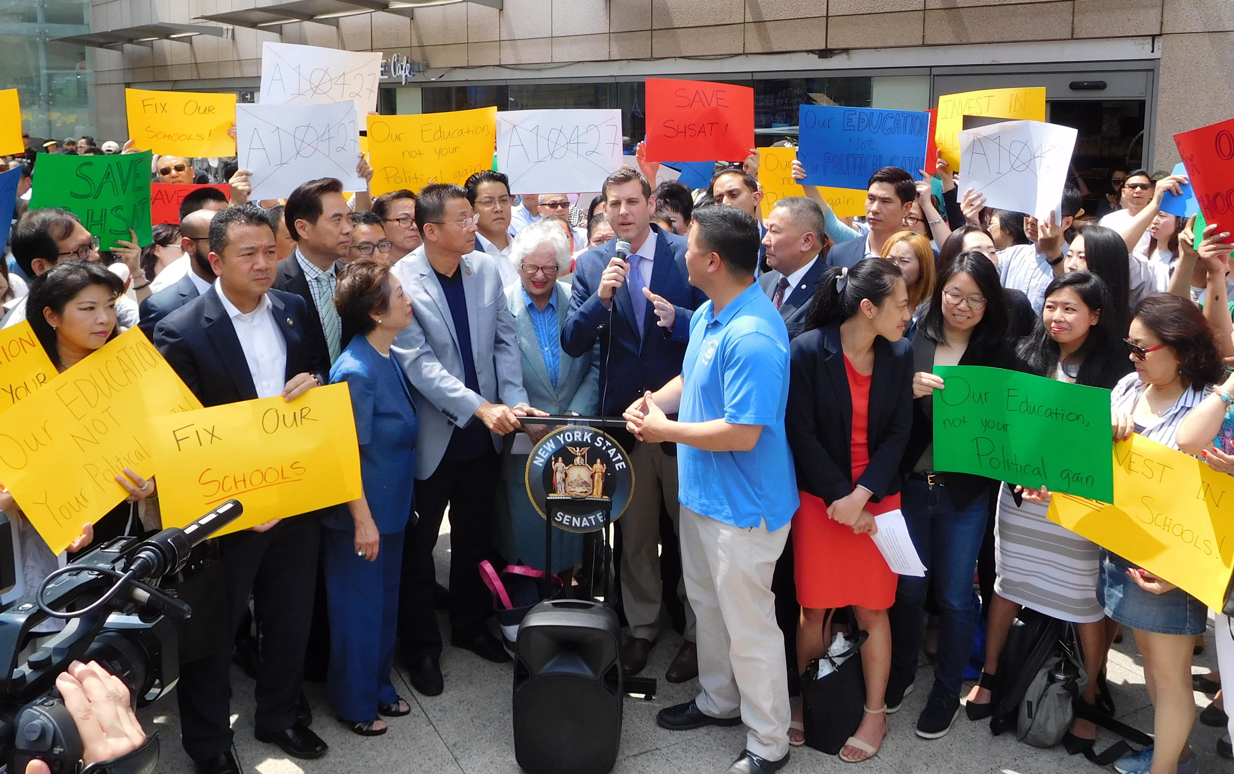 On June 8, 2018, Assemblyman Braunstein attended a rally against the proposed elimination of the Specialized High School Admissions Test.