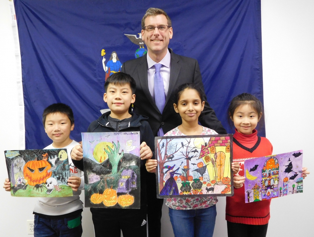 On November 30, 2018, Assemblyman Braunstein met with the winners of his annual Halloween Essay and Drawing Contest. Assemblyman Braunstein is pictured with 4th Grade Grand Prize Winner Lucas Jin; 5th