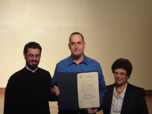Chief of Staff David Fischer at the William Spyropoulos Greek-American Day School  Greek Independence Day celebration. David presented an Assembly citation to Rev. Paul C. Palesty and Principal Athena Kromidas in honor of this special occasion.
