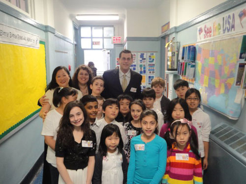 Assemblyman Braunstein with Parent Coordinator Mary Paik Bow, Career Day Coordinator Maria Plakas, and student escorts at PS 41's Career Day in Bayside