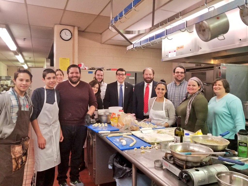 Assemblymember Daniel Rosenthal Councilman Rory Lancman learn to make gnocchi from the culinary students at Bnos Malka Academy