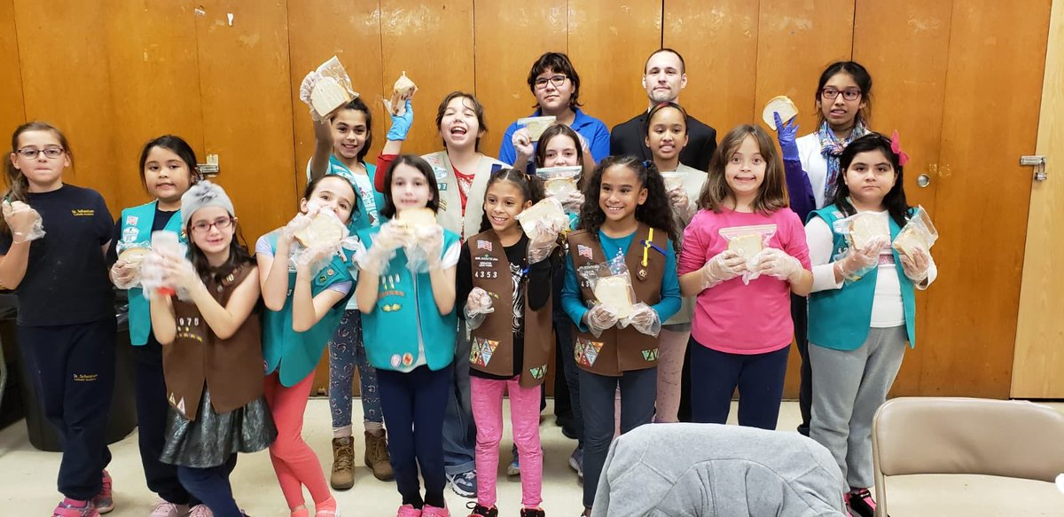 Local Girl Scouts joined our volunteer mission making sandwiches for the needy