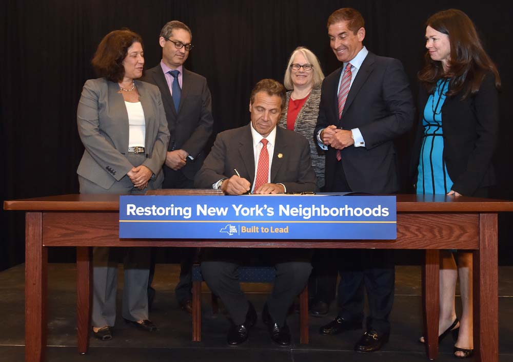 "Assemblywoman Weinstein joined Governor Cuomo as he signed into law the Assemblywoman's legislation, which will force banks and lenders to maintain ""zombie"" properties before and during the foreclosur"