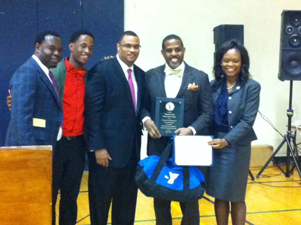 Assemblymember Bichotte at the Young at Heart and Men's Dinner at the Flatbush YMCA, with honoree State Senator Kevin Parker, and Executive Director, Meishay Gaddis, and fellow presenters.