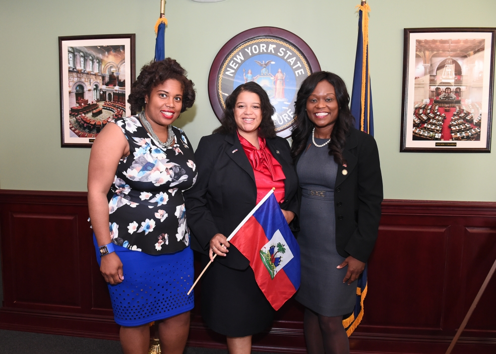 Assemblymember Rodneyse Bichotte (right) is joined by Assemblymembers Michaelle Solages and Kimberly Jean-Pierre in the Legislative Office Building as hosts and sponsors of Haitian Unity Day. Other ho