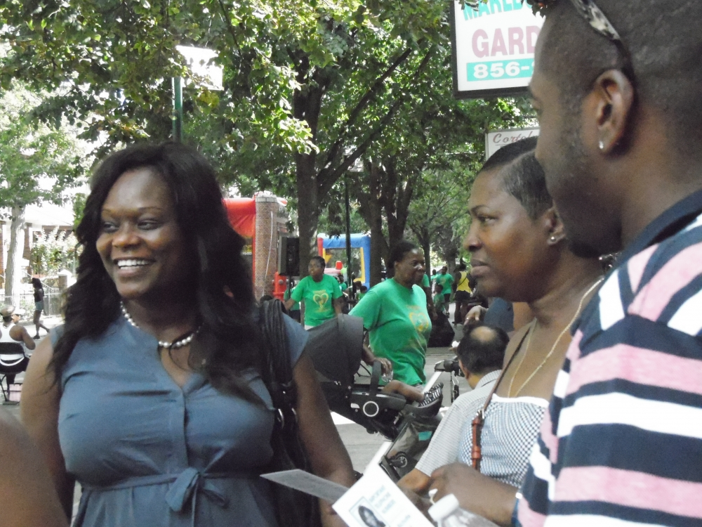 Assemblymember Bichotte speaks with parents during the block party hosted Cortelyou Road Early Childcare Center.