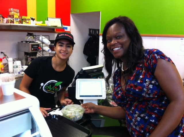 Assemblymember Bichotte sampling the offerings at the grand opening of Ovi's Express.