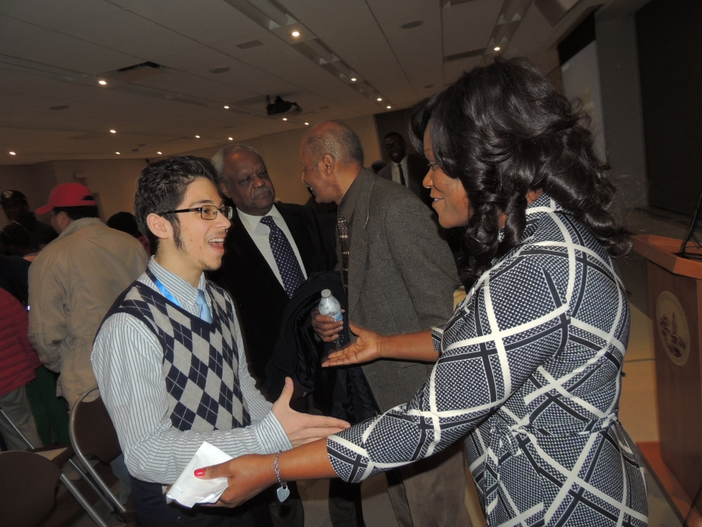 Assembly Member Rodneyse Bichotte greeting a constituent after her annual state of the district address