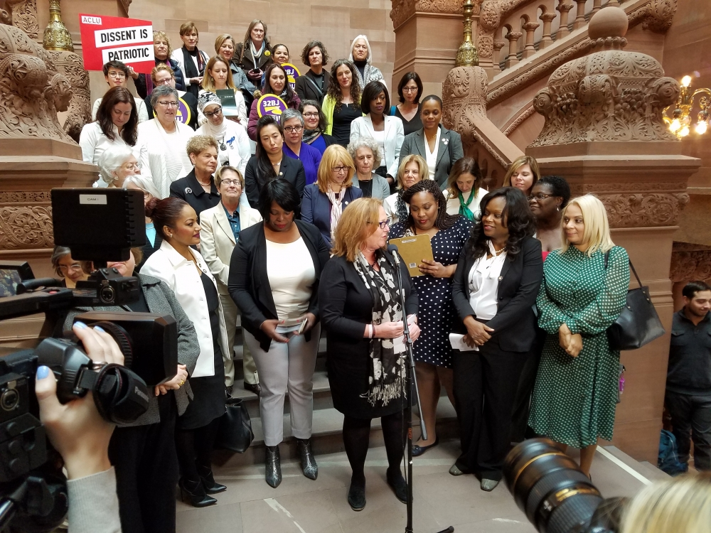 Assembly Member Rodneyse Bichotte pays homage to the Women's Suffrage Movement and speaks in support of voting rights legislation during a press conference in Albany along members of the Assembly
