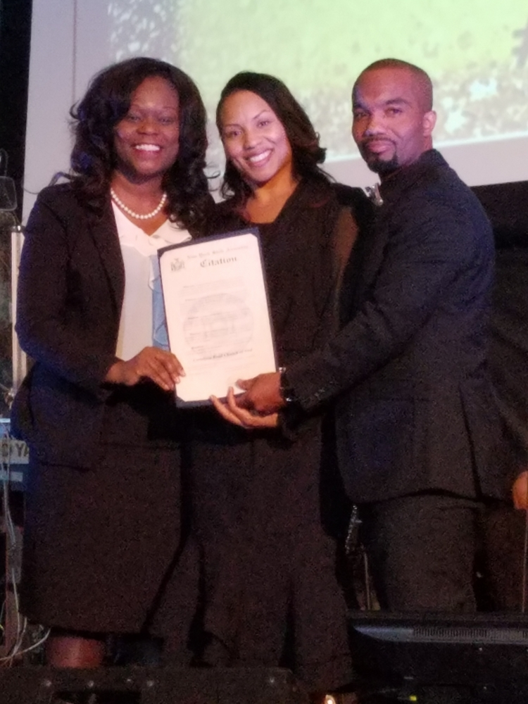Assembly Member Rodneyse Bichotte presents Pastors Diane and Richard St. Surin of the Cortelyou Road Church of God with a citation commemorating the church's 50th Anniversary.