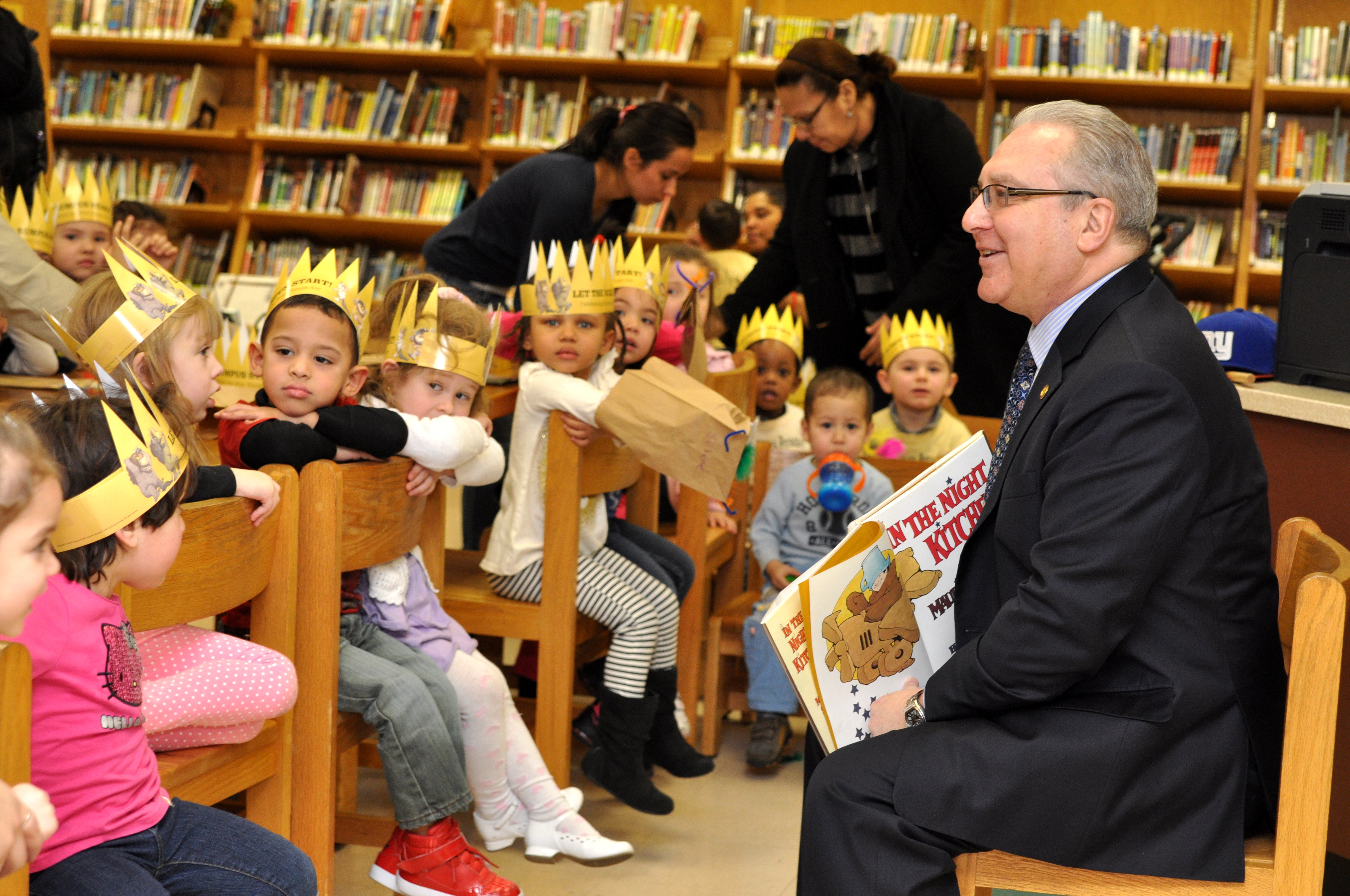 "Assemblyman Steven Cymbrowitz visits the Homecrest branch of the Brooklyn Public Library to read Maurice Sendak's ""In The Night Kitchen"" to preschoolers in honor of National Read Across America Day."